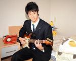 投げるギタリスト。